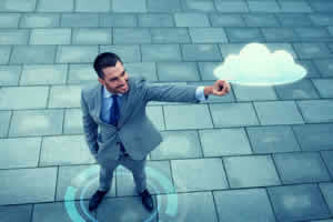 Image showing an IT manager using cloud computing.